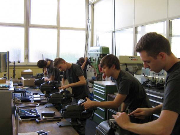 Apprentices filing a part at Brehm Präzisionstechnik GmbH & Co. KG